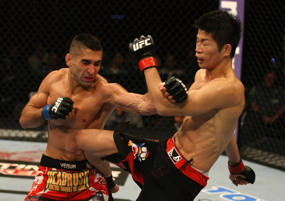 ATLANTIC CITY, NJ - JUNE 22:  Ricardo Lamas (L) punches Hatsu Hioki (R) who returns with a kick in a featherweight bout during UFC on FX 4 at Revel Casino on June 22, 2012 in Atlantic City, New Jersey.  (Photo by Nick Laham/Zuffa LLC/Zuffa LLC)