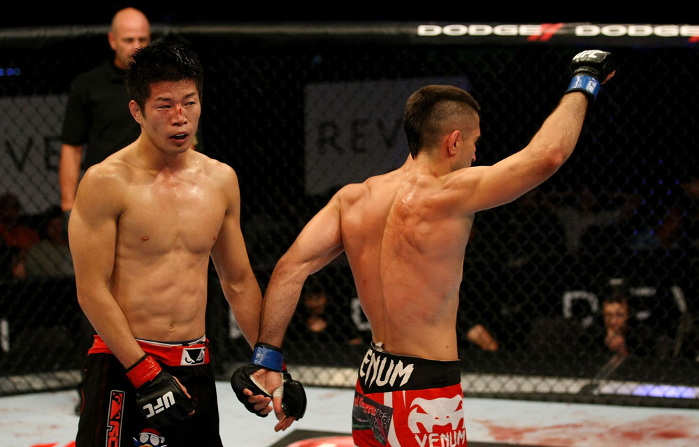 ATLANTIC CITY, NJ - JUNE 22:  Hatsu Hioki (L) walks away as Ricardo Lamas (R) celebrates after the third round of their featherweight bout during UFC on FX 4 at Revel Casino on June 22, 2012 in Atlantic City, New Jersey.  (Photo by Nick Laham/Zuffa LLC/Zuffa LLC)