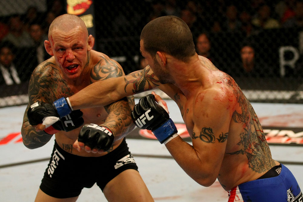ATLANTIC CITY, NJ - JUNE 22: Cub Swanson (R) punches Ross Pearson (L) in a featherweight bout during UFC on FX 4 at Revel Casino on June 22, 2012 in Atlantic City, New Jersey.  (Photo by Nick Laham/Zuffa LLC/Zuffa LLC)