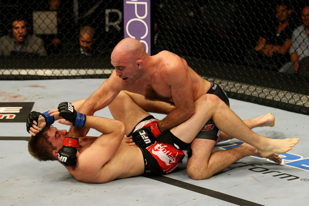 ATLANTIC CITY, NJ - JUNE 22: Brian Ebersole (R) punches T.J. Waldburger (L) in a welterweight bout during UFC on FX 4 at Revel Casino on June 22, 2012 in Atlantic City, New Jersey.  (Photo by Nick Laham/Zuffa LLC/Zuffa LLC)