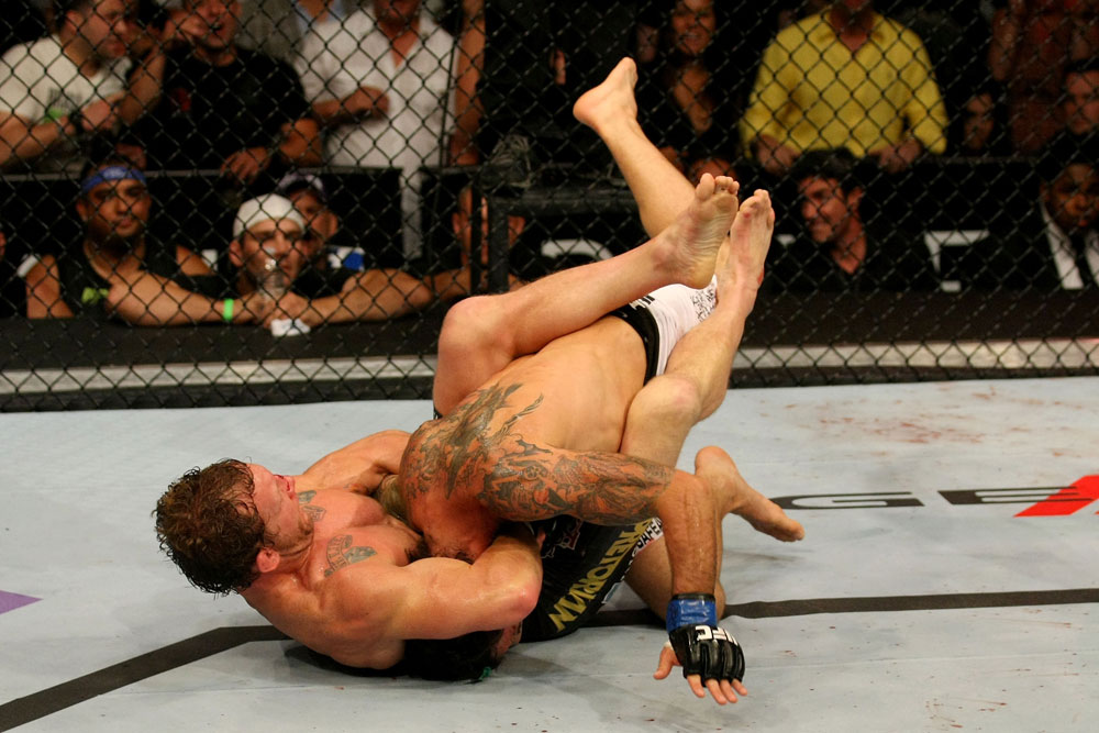 ATLANTIC CITY, NJ - JUNE 22: Gray Maynard (L) attempts a guillotine choke on Clay Guida (R) in the main event lightweight bout during UFC on FX 4 at Revel Casino on June 22, 2012 in Atlantic City, New Jersey.  (Photo by Nick Laham/Zuffa LLC/Zuffa LLC)