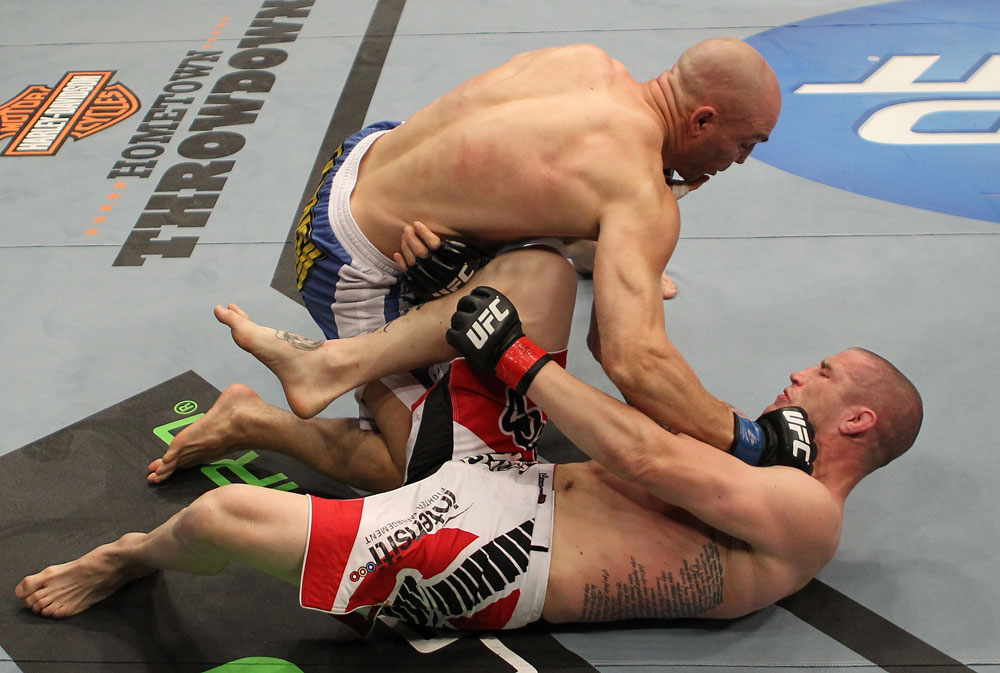 SUNRISE, FL - JUNE 08:   Sean Pierson (top) punches Jake Hecht in Welterweight bout during the UFC on FX 3 event at Bank Atlantic Center on June 8, 2012 in Sunrise, Florida.  (Photo by Josh Hedges/Zuffa LLC/Zuffa LLC via Getty Images)