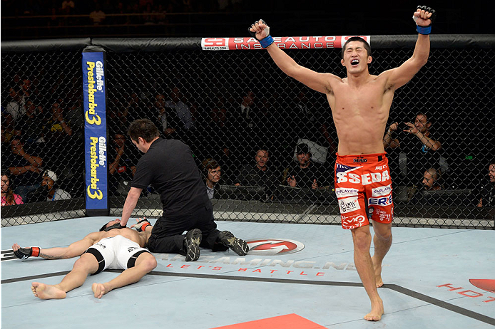 BARUERI, BRAZIL - OCTOBER 9:  (R-L) Dong Hyun Kim celebrates after knocking out Erick Silva in their welterweight bout during the UFC Fight Night event at the Ginasio Jose Correa on October 9, 2013 in Barueri, Sao Paulo, Brazil. (Photo by Jeff Bottari/Zuffa LLC/Zuffa LLC via Getty Images)