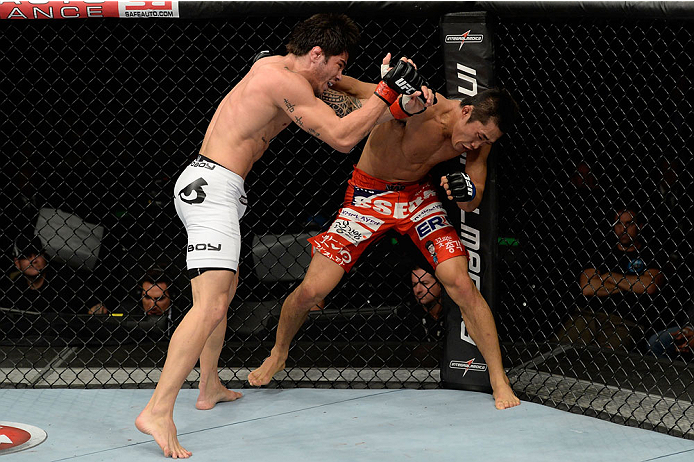 BARUERI, BRAZIL - OCTOBER 9:  (L-R) Dong Hyun Kim punches Erick Silva in their welterweight bout during the UFC Fight Night event at the Ginasio Jose Correa on October 9, 2013 in Barueri, Sao Paulo, Brazil. (Photo by Jeff Bottari/Zuffa LLC/Zuffa LLC via Getty Images)