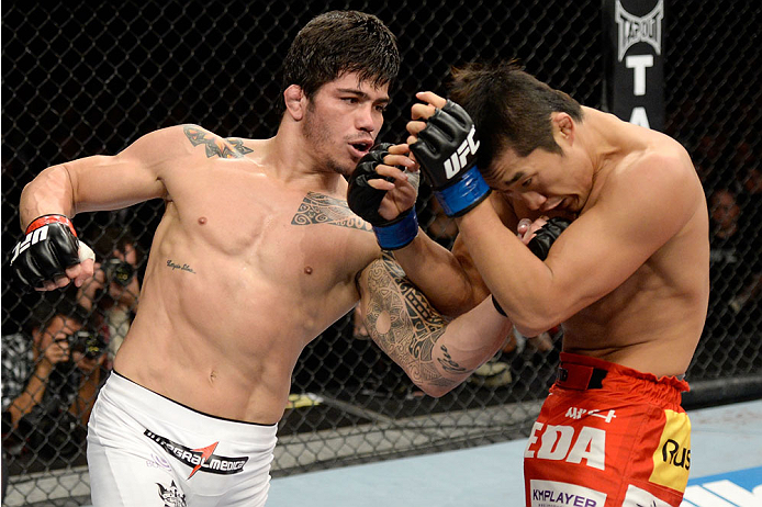 BARUERI, BRAZIL - OCTOBER 9:  (L-R) Erick Silva punches Dong Hyun Kim in their welterweight bout during the UFC Fight Night event at the Ginasio Jose Correa on October 9, 2013 in Barueri, Sao Paulo, Brazil. (Photo by Jeff Bottari/Zuffa LLC/Zuffa LLC via Getty Images)