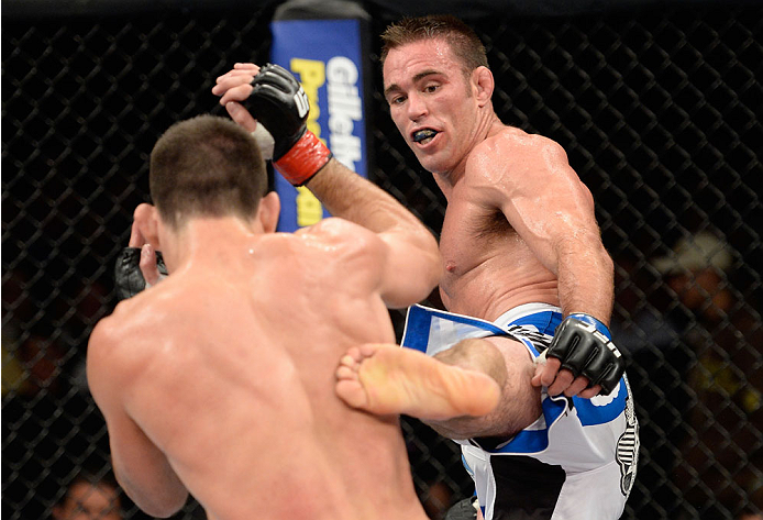 BARUERI, BRAZIL - OCTOBER 9:  (R-L) Jake Shields kicks Demian Maia in their welterweight bout during the UFC Fight Night event at the Ginasio Jose Correa on October 9, 2013 in Barueri, Sao Paulo, Brazil. (Photo by Jeff Bottari/Zuffa LLC/Zuffa LLC via Getty Images)