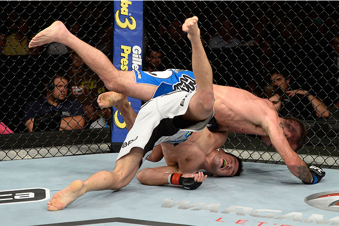 BARUERI, BRAZIL - OCTOBER 9:  Jake Shields (blue shorts) jumps on Demian Maia (white shorts) in their welterweight bout during the UFC Fight Night event at the Ginasio Jose Correa on October 9, 2013 in Barueri, Sao Paulo, Brazil. (Photo by Jeff Bottari/Zuffa LLC/Zuffa LLC via Getty Images)