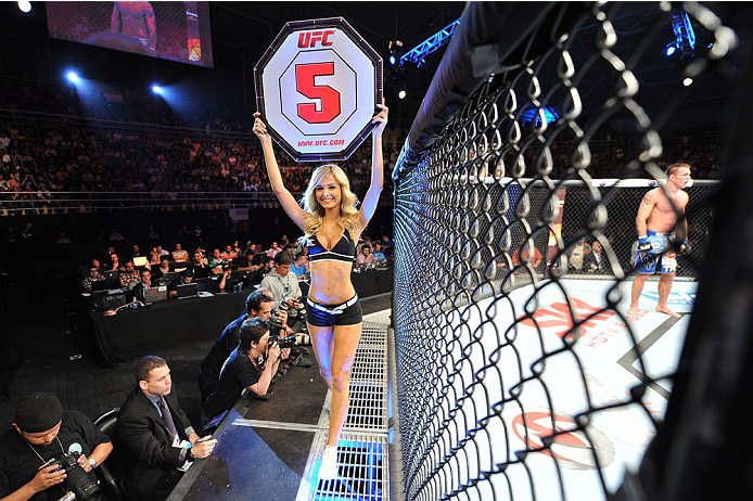 BARUERI, BRAZIL - OCTOBER 9:  UFC Octagon Girl Jhenny Andrade walks the Octagon before round five for the welterweight bout between Jake Shields and Demian Maia during the UFC Fight Night event at the Ginasio Jose Correa on October 9, 2013 in Barueri, Sao Paulo, Brazil. (Photo by Jeff Bottari/Zuffa LLC/Zuffa LLC via Getty Images)