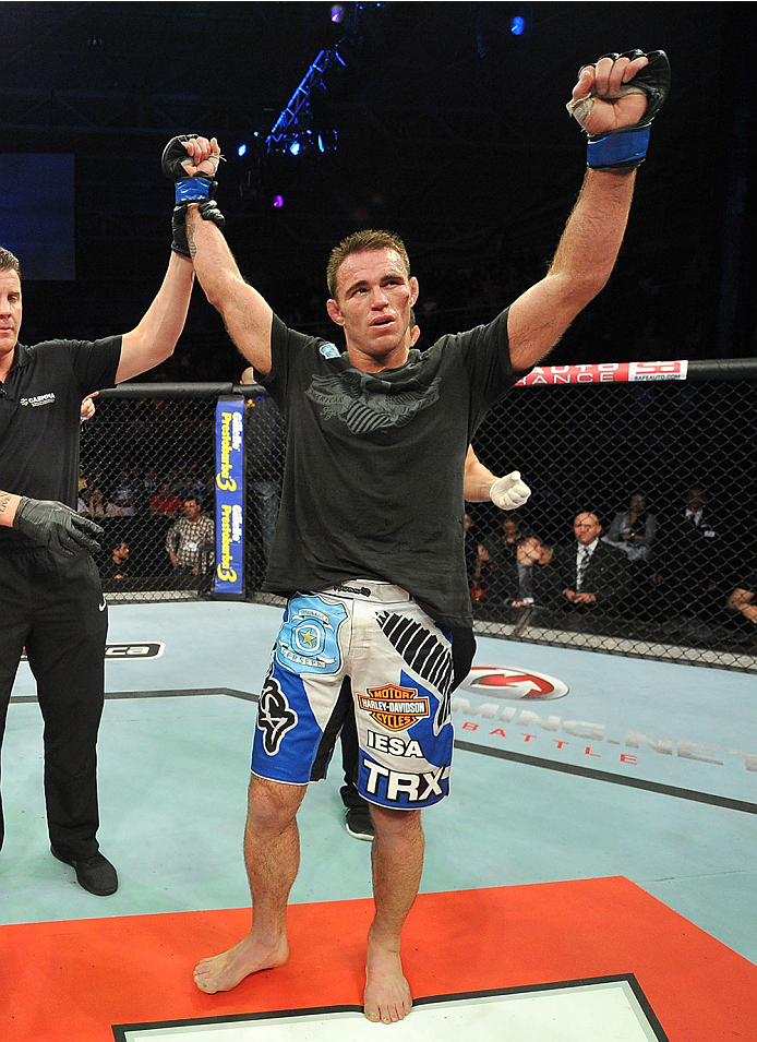 BARUERI, BRAZIL - OCTOBER 9:  (R-L) Jake Shields celebrates after defeating Demian Maia in their welterweight bout during the UFC Fight Night event at the Ginasio Jose Correa on October 9, 2013 in Barueri, Sao Paulo, Brazil. (Photo by Jeff Bottari/Zuffa LLC/Zuffa LLC via Getty Images)