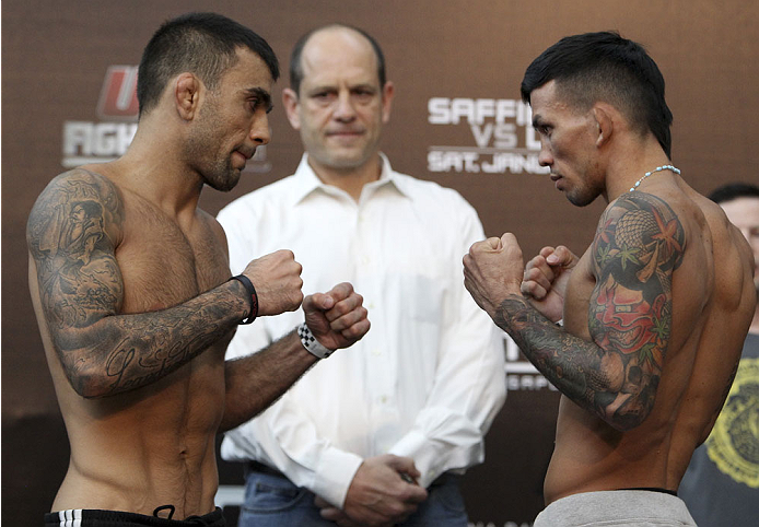 SINGAPORE - JANUARY 03:  (L and R) Leandro Issa and Russell Doane face off during the UFC Fight Night Singapore Weigh-in at the Shoppes at Marina Bay Sands on January 3, 2014 in Singapore. (Photo by Mitch Viquez/Zuffa LLC/Zuffa LLC via Getty Images)