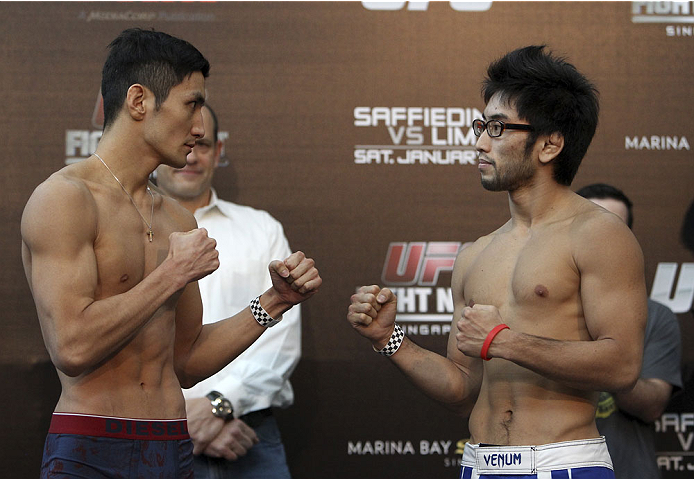 SINGAPORE - JANUARY 03: (L and R) Kang Kyung Ho and Shunichi Shimizu face off during the UFC Fight Night Singapore Weigh-in at the Shoppes at Marina Bay Sands on January 3, 2014 in Singapore. (Photo by Mitch Viquez/Zuffa LLC/Zuffa LLC via Getty Images)