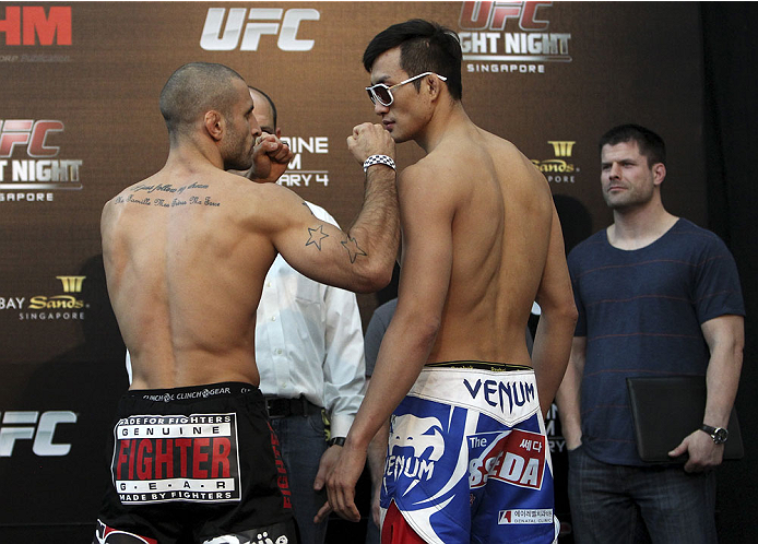 SINGAPORE - JANUARY 03:  (L and R) Tarec Saffiedine and Lim Hyun Gyu face off during the UFC Fight Night Singapore Weigh-in at the Shoppes at Marina Bay Sands on January 3, 2014 in Singapore. (Photo by Mitch Viquez/Zuffa LLC/Zuffa LLC via Getty Images)