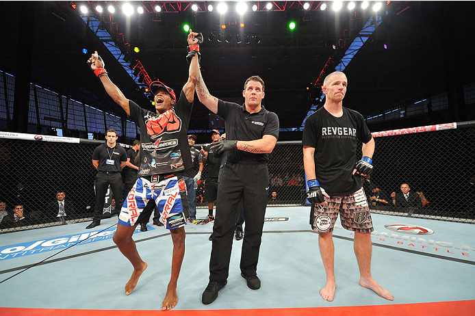 BARUERI, BRAZIL - OCTOBER 9:  (L-R) Alan Patrick celebrates after defeating Garett Whiteley in their lightweight bout during the UFC Fight Night event at the Ginasio Jose Correa on October 9, 2013 in Barueri, Sao Paulo, Brazil. (Photo by Jeff Bottari/Zuffa LLC/Zuffa LLC via Getty Images)