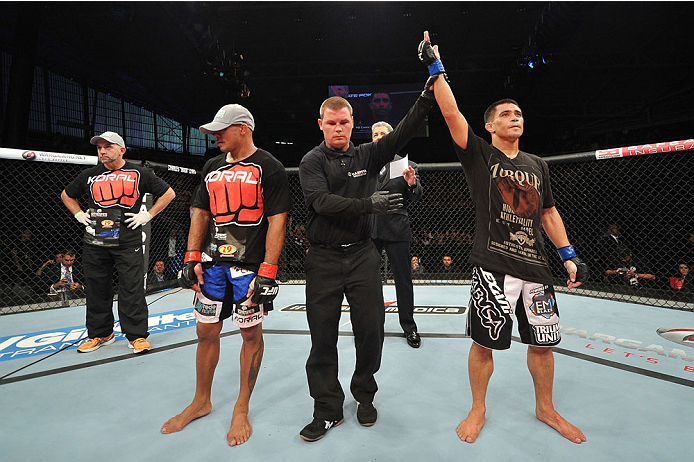 BARUERI, BRAZIL - OCTOBER 9:  (R-L) Chris Cariaso celebrates after defeating Iliarde Santos in their flyweight bout during the UFC Fight Night event at the Ginasio Jose Correa on October 9, 2013 in Barueri, Sao Paulo, Brazil. (Photo by Jeff Bottari/Zuffa LLC/Zuffa LLC via Getty Images)