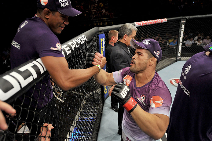 BARUERI, BRAZIL - OCTOBER 9:  Rousimar Palhares celebrates with his corner after defeating Mike Pierce (not pictured) in their welterweight bout during the UFC Fight Night event at the Ginasio Jose Correa on October 9, 2013 in Barueri, Sao Paulo, Brazil. (Photo by Jeff Bottari/Zuffa LLC/Zuffa LLC via Getty Images)