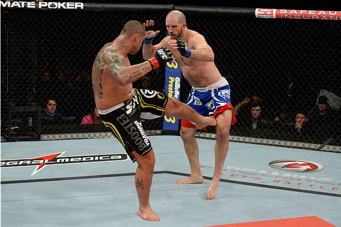 BARUERI, BRAZIL - OCTOBER 9:  (L-R) Thiago Silva kicks Matt Hamill in their light heavyweight bout during the UFC Fight Night event at the Ginasio Jose Correa on October 9, 2013 in Barueri, Sao Paulo, Brazil. (Photo by Jeff Bottari/Zuffa LLC/Zuffa LLC via Getty Images)