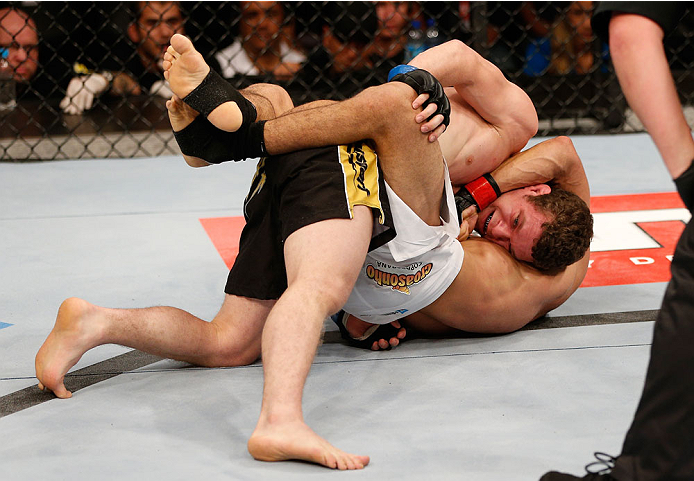 GOIANIA, BRAZIL - NOVEMBER 09: (R-L) Jose Maria attempts a guillotine choke submission against Dustin Ortiz in their flyweight bout during the UFC event at Arena Goiania on November 9, 2013 in Goiania, Brazil. (Photo by Josh Hedges/Zuffa LLC/Zuffa LLC via Getty Images)