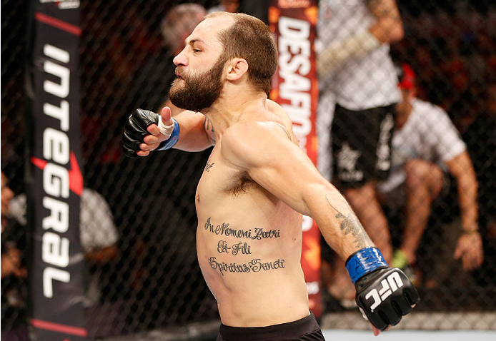 GOIANIA, BRAZIL - NOVEMBER 09: Sam Sicilia reacts after knocking out Godofredo ''Pepey'' Castro in their featherweight bout during the UFC event at Arena Goiania on November 9, 2013 in Goiania, Brazil. (Photo by Josh Hedges/Zuffa LLC/Zuffa LLC via Getty Images)