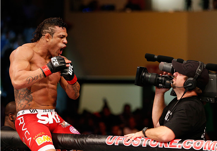 GOIANIA, BRAZIL - NOVEMBER 09:  Vitor Belfort reacts after knocking out Dan Henderson in their light heavyweight bout during the UFC event at Arena Goiania on November 9, 2013 in Goiania, Brazil. (Photo by Josh Hedges/Zuffa LLC/Zuffa LLC via Getty Images)