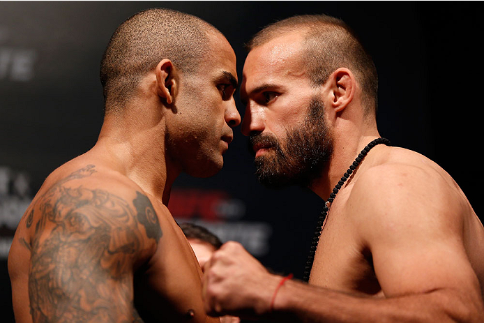 "GOIANIA, BRAZIL - NOVEMBER 08:  (L-R) Opponents Rafael ""Fejao"" Cavalcante and Igor Pokrajac face off during the UFC weigh-in event at Arena Goiania on November 8, 2013 in Goiania, Brazil. (Photo by Josh Hedges/Zuffa LLC/Zuffa LLC via Getty Images)"