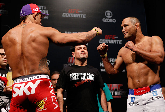 GOIANIA, BRAZIL - NOVEMBER 08:  (L-R) Opponents Vitor Belfort and Dan Henderson face off during the UFC weigh-in event at Arena Goiania on November 8, 2013 in Goiania, Brazil. (Photo by Josh Hedges/Zuffa LLC/Zuffa LLC via Getty Images)