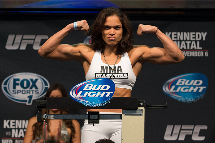 CLARKSVILLE, TN - NOVEMBER 5:  Amanda Nunes weighs in during the UFC Fight For the Troops weigh-in at the Fort Campbell Sabre Air Field hanger on November 5, 2013 in Clarksville, Tennessee. (Photo by Ed Mulholland/Zuffa LLC/Zuffa LLC via Getty Images)