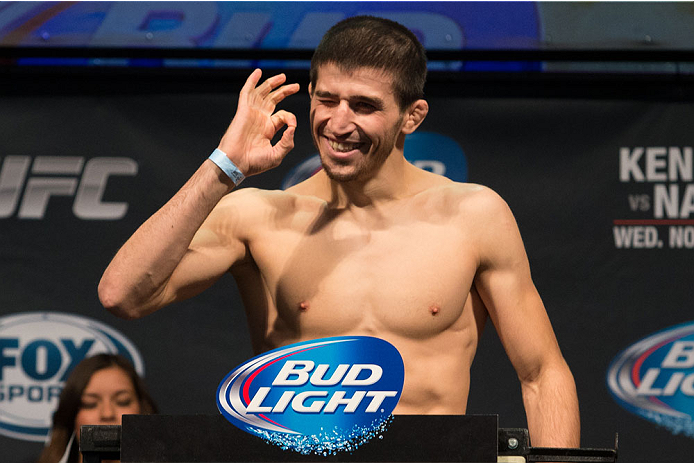 CLARKSVILLE, TN - NOVEMBER 5:  Rustam Khabilov weighs in during the UFC Fight For the Troops weigh-in at the Fort Campbell Sabre Air Field hanger on November 5, 2013 in Clarksville, Tennessee. (Photo by Ed Mulholland/Zuffa LLC/Zuffa LLC via Getty Images)