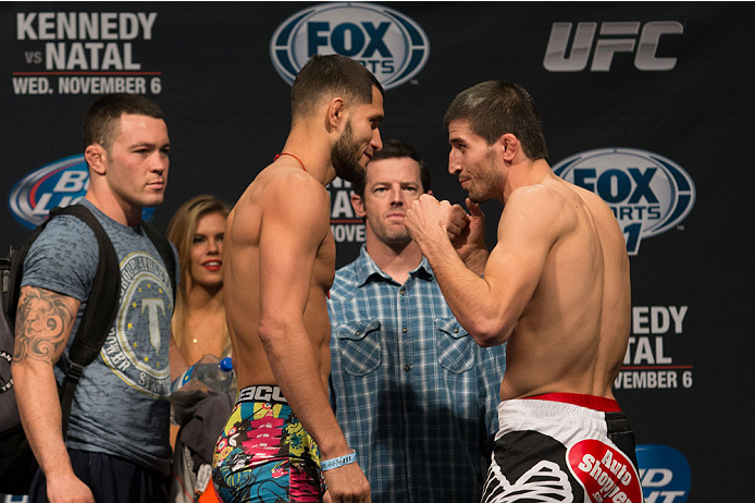 CLARKSVILLE, TN - NOVEMBER 5:  Jorge Masvidal (L) and Rustam Khabilov (R) face off during the UFC Fight For the Troops weigh-in at the Fort Campbell Sabre Air Field hanger on November 5, 2013 in Clarksville, Tennessee. (Photo by Ed Mulholland/Zuffa LLC/Zuffa LLC via Getty Images)
