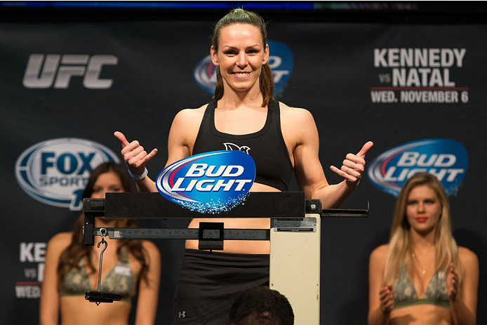CLARKSVILLE, TN - NOVEMBER 5:  Alexis Davis weighs in during the UFC Fight For the Troops weigh-in at the Fort Campbell Sabre Air Field hanger on November 5, 2013 in Clarksville, Tennessee. (Photo by Ed Mulholland/Zuffa LLC/Zuffa LLC via Getty Images)