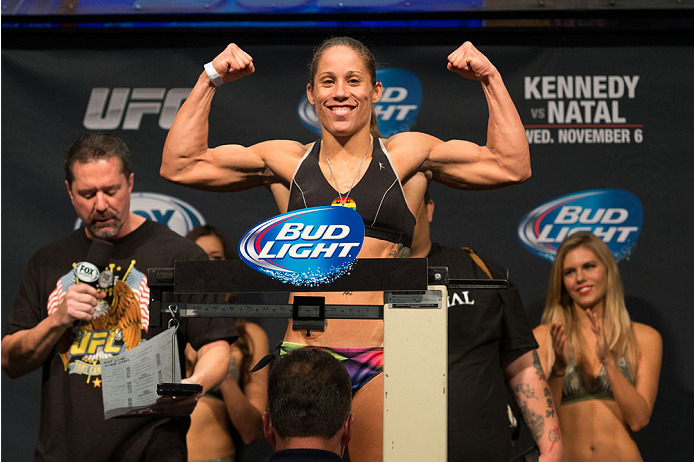 CLARKSVILLE, TN - NOVEMBER 5:  Liz Carmouche weighs in during the UFC Fight For the Troops weigh-in at the Fort Campbell Sabre Air Field hanger on November 5, 2013 in Clarksville, Tennessee. (Photo by Ed Mulholland/Zuffa LLC/Zuffa LLC via Getty Images)