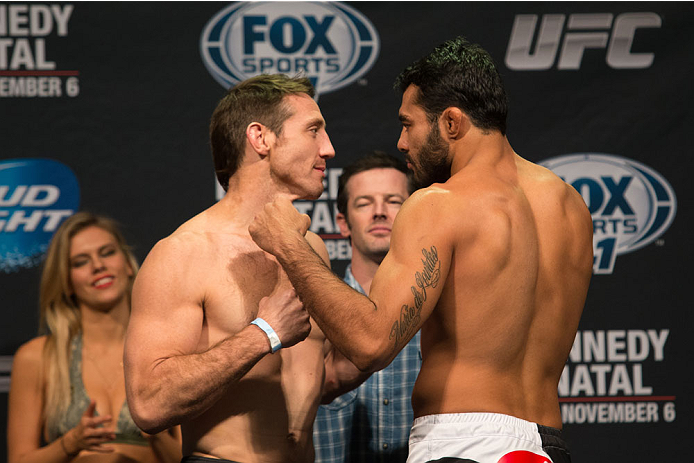 CLARKSVILLE, TN - NOVEMBER 5:  Tim Kennedy (L) and Rafael Natal (R) face off during the UFC Fight For the Troops weigh-in at the Fort Campbell Sabre Air Field hanger on November 5, 2013 in Clarksville, Tennessee. (Photo by Ed Mulholland/Zuffa LLC/Zuffa LLC via Getty Images)