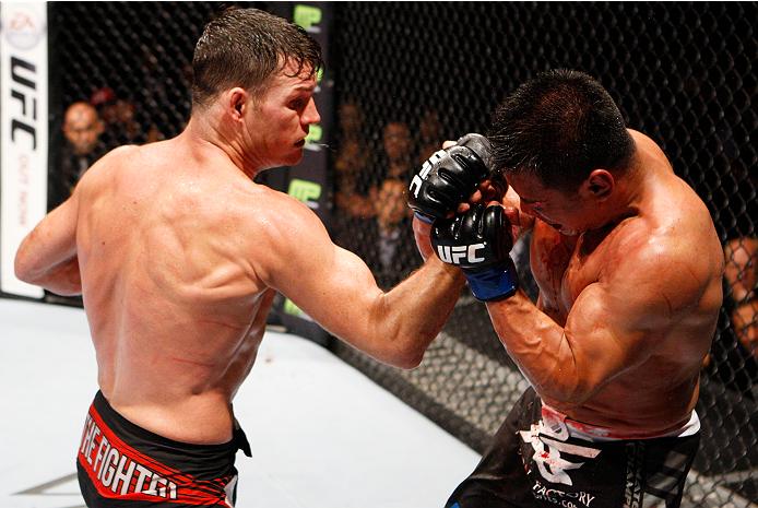 MACAU - AUGUST 23: Michael Bisping throws a punch at Cung Le in their middleweight fight during the UFC Fight Night event at the Venetian Macau on August 23, 2014 in Macau. (Photo by Mitch Viquez/Zuffa LLC/Zuffa LLC via Getty Images)