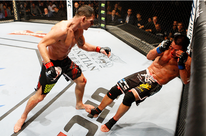 Michael Bisping (left) knocks down Cung Le.