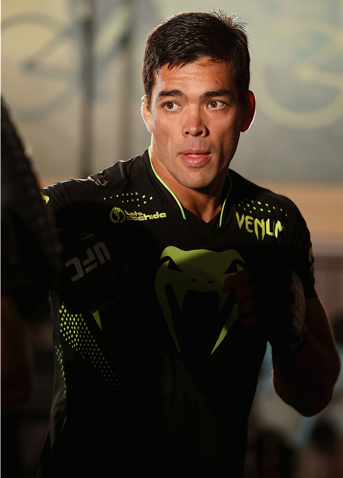 MANCHESTER, ENGLAND - OCTOBER 23:  Lyoto Machida holds an open training session for media inside Shooterâs Sports Bar on October 23, 2013 in Manchester, England. (Photo by Josh Hedges/Zuffa LLC/Zuffa LLC via Getty Images)