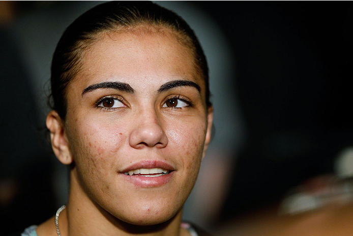 MANCHESTER, ENGLAND - OCTOBER 23:  Jessica Andrade interacts with media after the UFC open workouts inside Shooterâs Sports Bar on October 23, 2013 in Manchester, England. (Photo by Josh Hedges/Zuffa LLC/Zuffa LLC via Getty Images)
