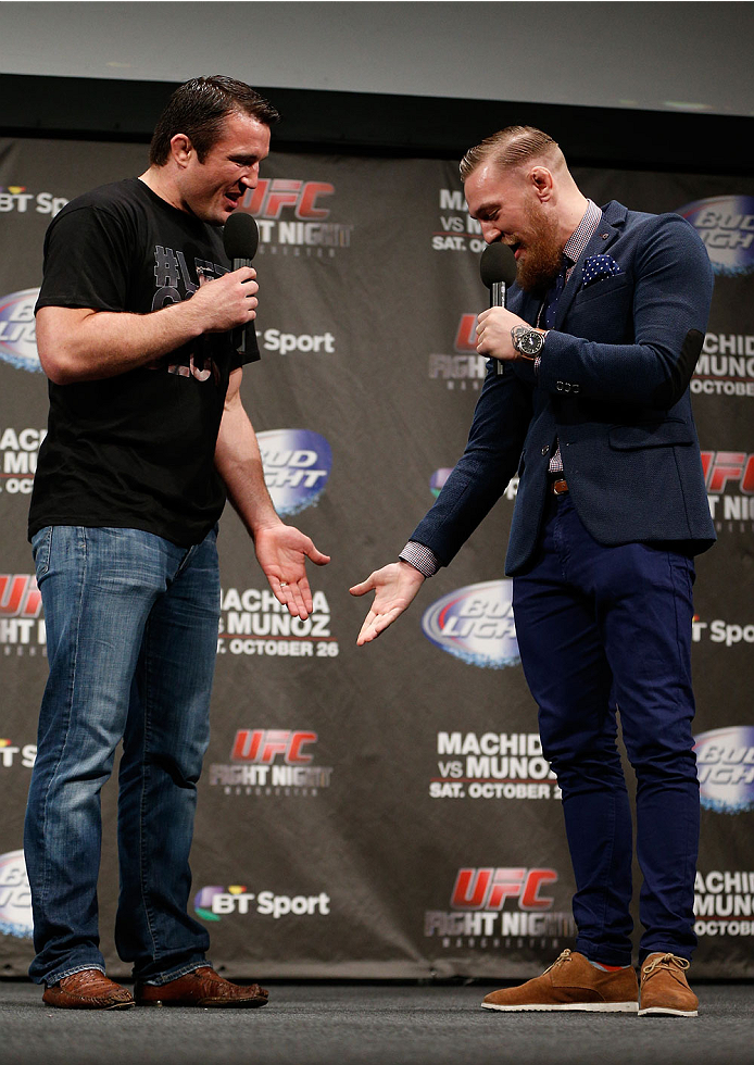 MANCHESTER, ENGLAND - OCTOBER 25:  (L-R) Chael Sonnen and Conor McGregor interact with fans during a Q&A session before the UFC weigh-in event at Manchester Central on October 25, 2013 in Manchester, England. (Photo by Josh Hedges/Zuffa LLC/Zuffa LLC via Getty Images)