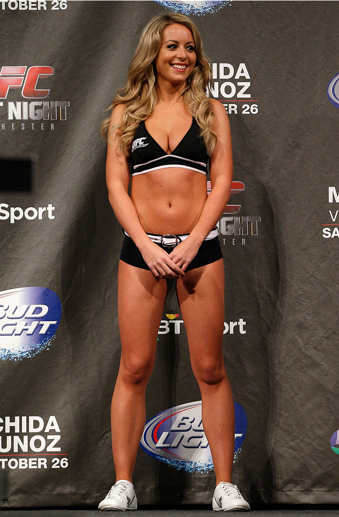 MANCHESTER, ENGLAND - OCTOBER 25:  UFC Octagon Girl Carly Baker stands on stage during the UFC weigh-in event at Manchester Central on October 25, 2013 in Manchester, England. (Photo by Josh Hedges/Zuffa LLC/Zuffa LLC via Getty Images)