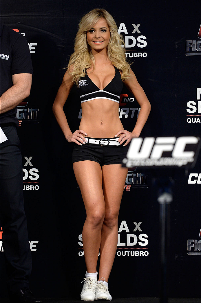 BARUERI, BRAZIL - OCTOBER 8:  UFC Octagon Girl Jhenny Andrade stands on stage during the UFC Fight Night: Maia v Shields weigh-in at the Ginasio Jose Correa on October 8, 2013 in Barueri, Sao Paulo, Brazil. (Photo by Jeff Bottari/Zuffa LLC/Zuffa LLC via Getty Images)