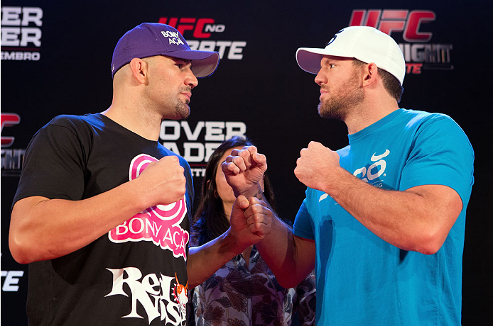 BELO HORIZONTE, BRAZIL - SEPTEMBER 02:  (L-R) Opponents Glover Teixeira and Ryan Bader face off after an open training session for media at the Ouro Minas Palace Hotel on September 2, 2013 in Belo Horizonte, Brazil. (Photo by Josh Hedges/Zuffa LLC/Zuffa LLC via Getty Images)