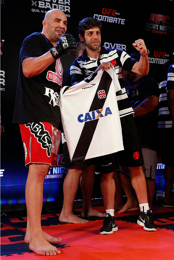 BELO HORIZONTE, BRAZIL - SEPTEMBER 02:  (R-L) Juninho of Vasco da Gama presents Glover Teixeira with a jersey after an open training session for media at the Ouro Minas Palace Hotel on September 2, 2013 in Belo Horizonte, Brazil. (Photo by Josh Hedges/Zuffa LLC/Zuffa LLC via Getty Images)