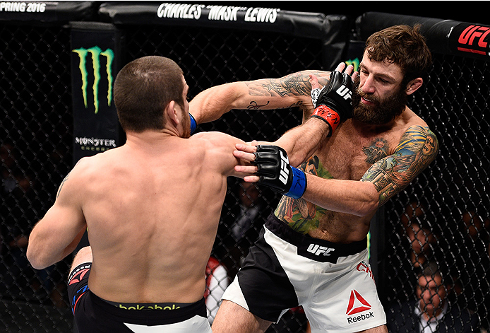 LAS VEGAS, NEVADA - DECEMBER 10:  (L) Jim Miller exchanges punches with Michael Chiesa in their lightweight bout during the UFC Fight Night event at The Chelsea at the Cosmopolitan of Las Vegas on December 10, 2015 in Las Vegas, Nevada.  (Photo by Jeff Bottari/Zuffa LLC/Zuffa LLC via Getty Images)