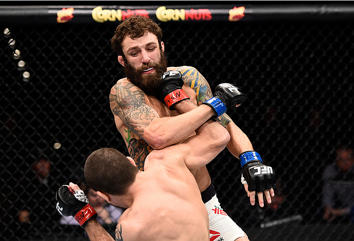 LAS VEGAS, NEVADA - DECEMBER 10:  (Bottom) Jim Miller punches Michael Chiesa in their lightweight bout during the UFC Fight Night event at The Chelsea at the Cosmopolitan of Las Vegas on December 10, 2015 in Las Vegas, Nevada.  (Photo by Jeff Bottari/Zuffa LLC/Zuffa LLC via Getty Images)