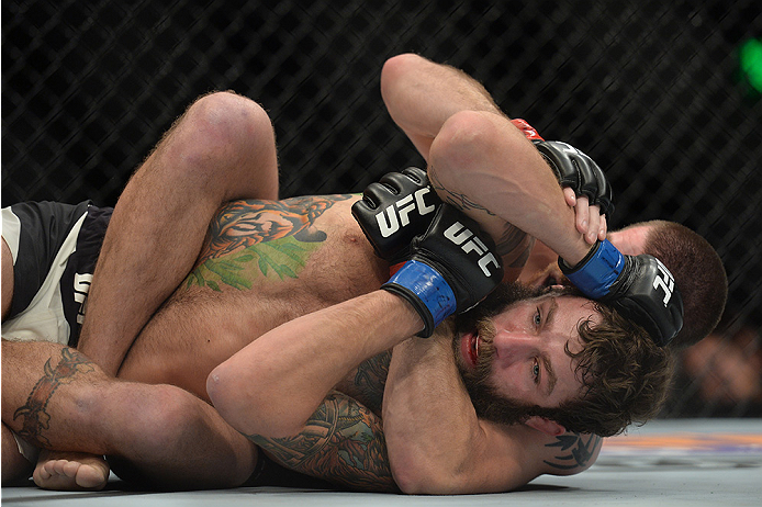 LAS VEGAS, NEVADA - DECEMBER 10:  (Back) Jim Miller attempts a submission on Michael Chiesa in their lightweight bout during the UFC Fight Night event at The Chelsea at the Cosmopolitan of Las Vegas on December 10, 2015 in Las Vegas, Nevada.  (Photo by Brandon Magnus/Zuffa LLC/Zuffa LLC via Getty Images)