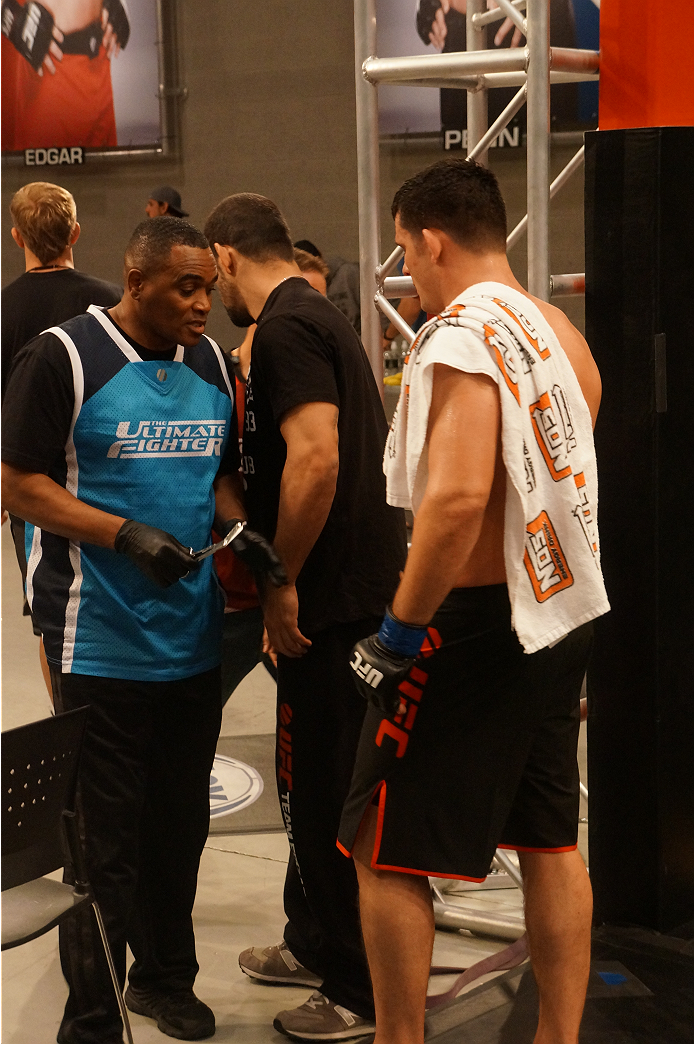 Pat Walsh gets his gloves removed after his bout.