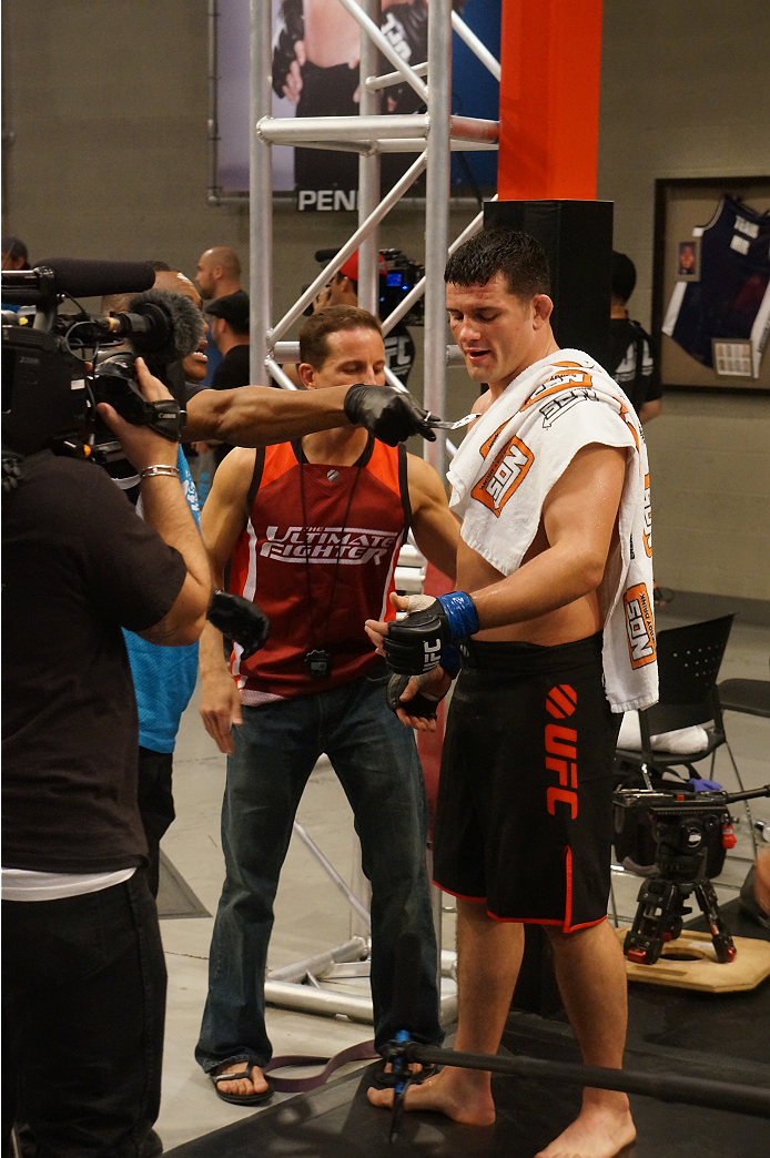 A bruised Pat Walsh prepares for his post-fight interview.