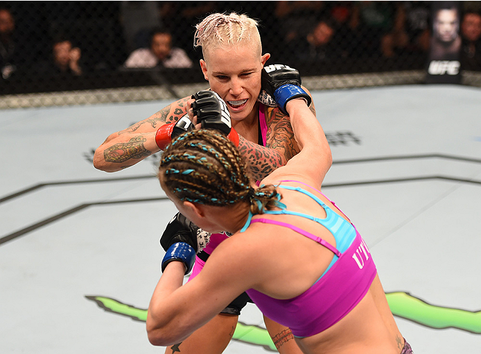 ADELAIDE, AUSTRALIA - MAY 10: (R-L) <a href='../fighter/Lisa-Ellis'>Lisa Ellis</a> punches <a href='../fighter/Bec-Rawlings'>Bec Rawlings</a> in their women's strawweight bout during the UFC Fight Night event at the Adelaide Entertainment Centre on May 10, 2015 in Adelaide, Australia. (Photo by Josh Hedges/Zuffa LLC/Zuffa LLC via Getty Images)