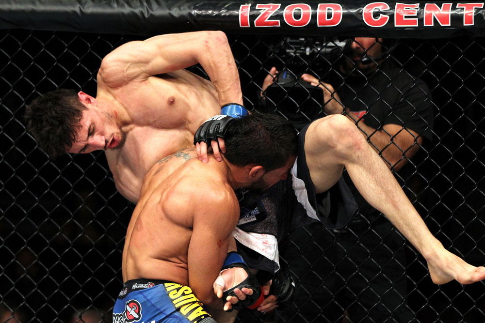 EAST RUTHERFORD, NJ - MAY 05:  Dennis Bermudez throws Pablo Garza into the cage during thier Bantamweight bout at Izod Center on May 5, 2012 in East Rutherford, New Jersey.  (Photo by Josh Hedges/Zuffa LLC/Zuffa LLC via Getty Images)