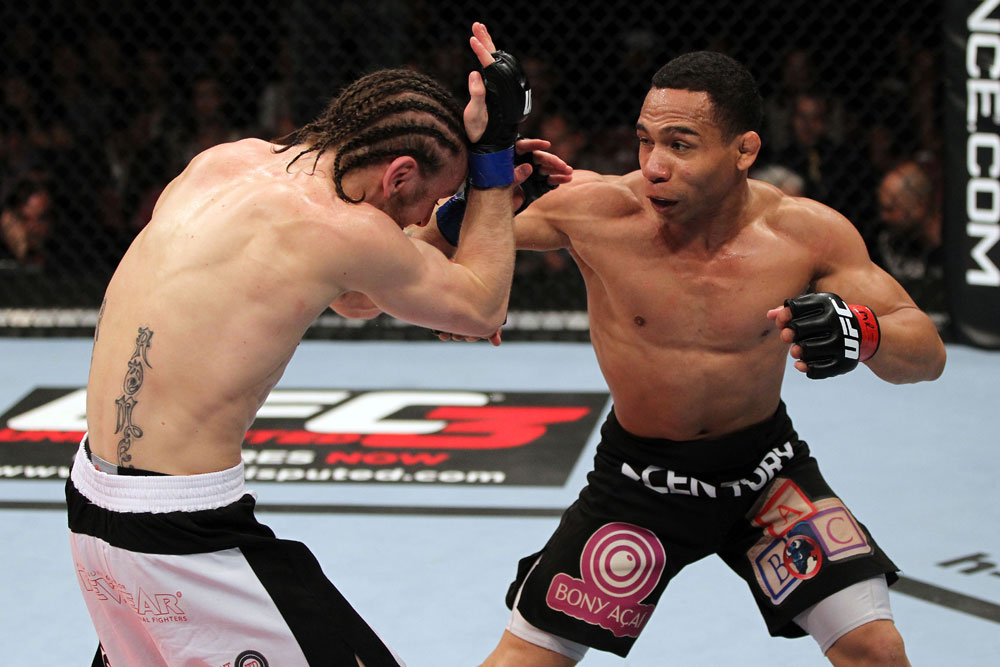 EAST RUTHERFORD, NJ - MAY 05:  John Dodson (R) punches Timothy Elliott (L) during thier Flyweight bout at Izod Center on May 5, 2012 in East Rutherford, New Jersey.  (Photo by Josh Hedges/Zuffa LLC/Zuffa LLC via Getty Images)