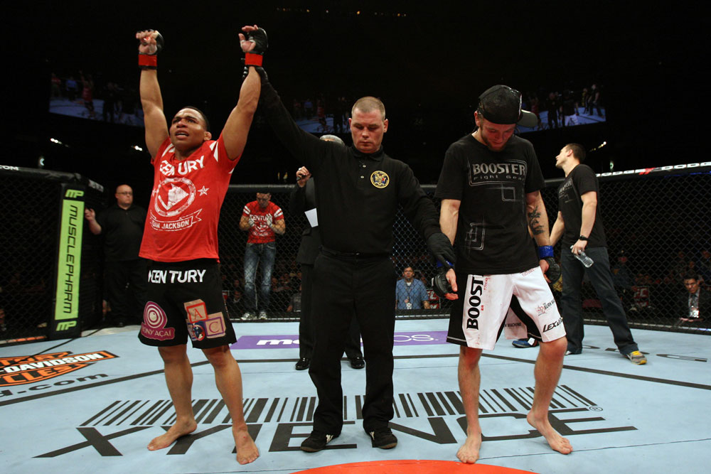EAST RUTHERFORD, NJ - MAY 05:  John Dodson (L) celebrates after defeating Timothy Elliott (R) during thier Flyweight bout at Izod Center on May 5, 2012 in East Rutherford, New Jersey.  (Photo by Josh Hedges/Zuffa LLC/Zuffa LLC via Getty Images)