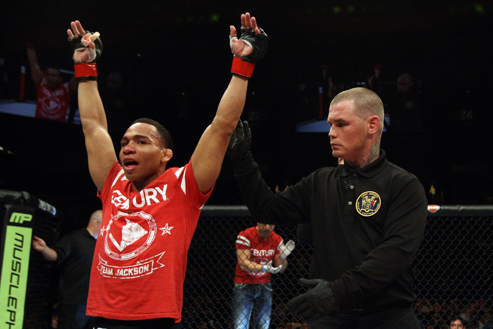 EAST RUTHERFORD, NJ - MAY 05:  John Dodson celebrates after defeating Timothy Elliott during thier Flyweight bout at Izod Center on May 5, 2012 in East Rutherford, New Jersey.  (Photo by Josh Hedges/Zuffa LLC/Zuffa LLC via Getty Images)